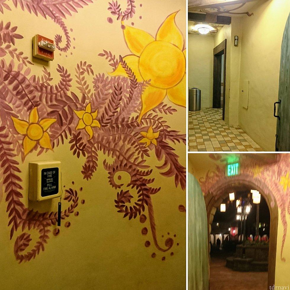 ドアを開けると、ラプンツェルのドレスと髪の色合いの素敵な壁画が。