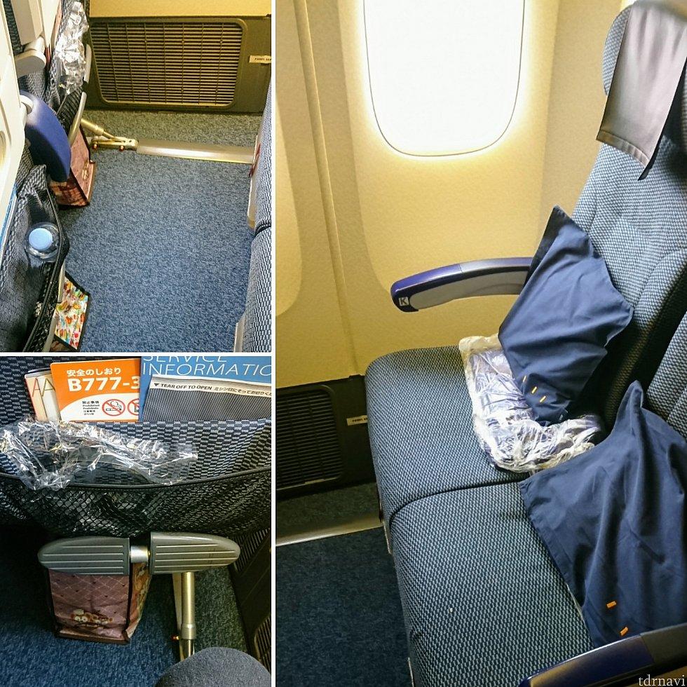 エコノミーの座席。後方の窓際側2席の所なので、横と足元が少し広いです。でもモニターは椅子に対して若干斜めに。フットレスト付き。
